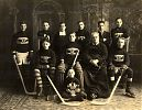 St. Ann's Montreal Young Men's Society - Fr. George Mylett (Coach; front row, 2nd from right) and the Intermediate Hockey Champions with the Art Ross trophy. 1922.