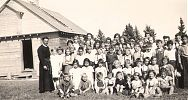 Fr. Joseph Owens with the children of Sudeten refugees. Dawson Creek, BC, 1940.